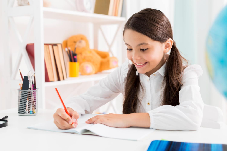 exited-cute-schoolgirl-uniform-studying-home.jpg